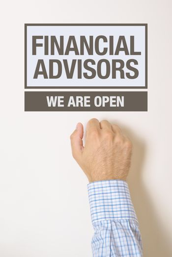 Businessman knocking on Financial Advisors office door looking for a help or advice