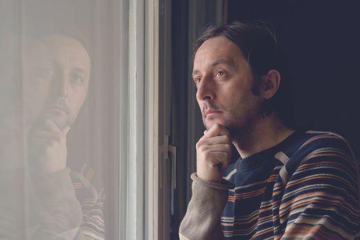 Sad man by the window