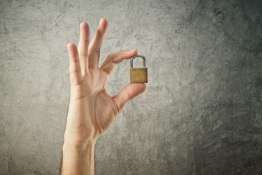 Hand holding padlock