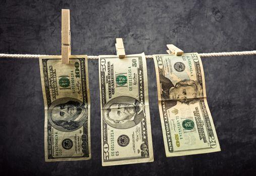 American Dollars hanging on rope