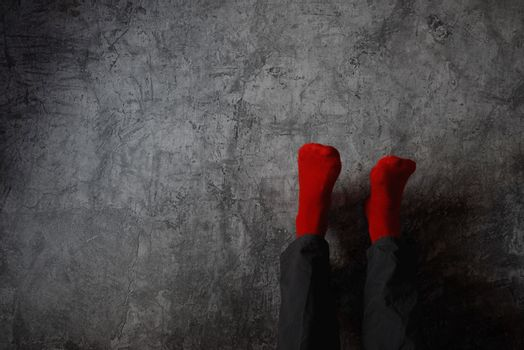 Legs up the wall, putting feet up