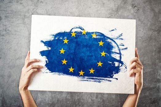 European Union flag. Man holding banner with EU Flag.