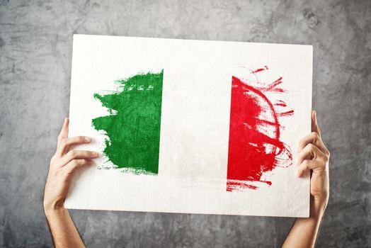 Italy flag. Man holding banner with Italian Flag.