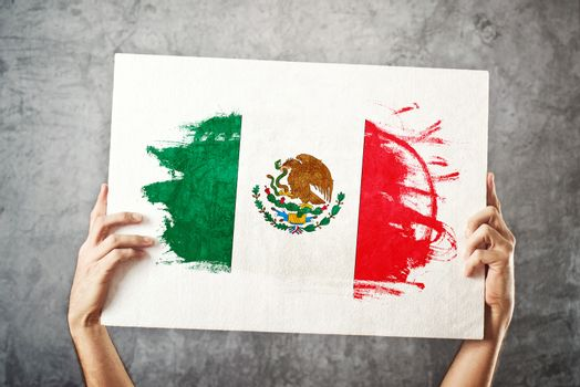 Mexico flag. Man holding banner with Mexican Flag.