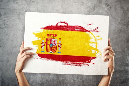 Spain flag. Man holding banner with Spanish Flag.
