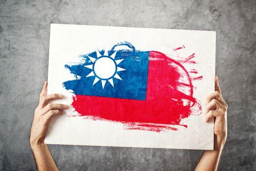 Taiwan flag. Man holding banner with taiwan Flag.