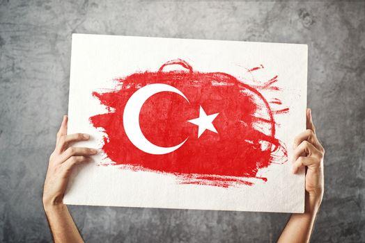 Turkey flag. Man holding banner with Turkish Flag.