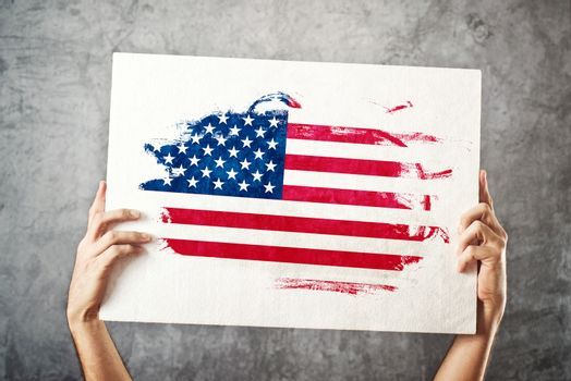 American flag. Man holding banner with USA Flag.