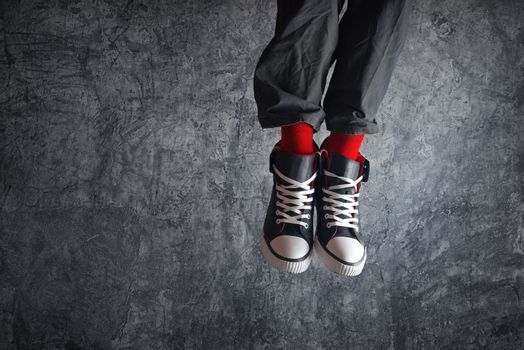 Excited man in sneakers jumping