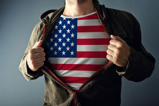 Man stretching jacket to reveal shirt with USA flag