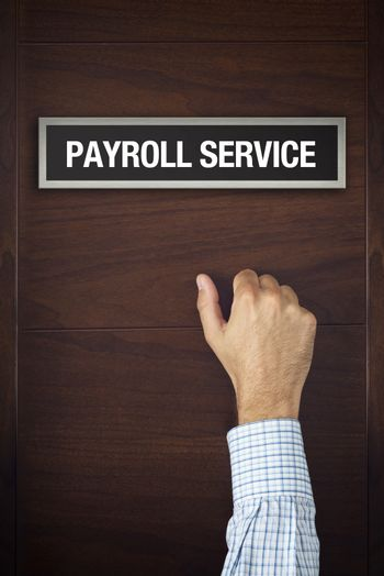 Businessman is knocking on Payroll service door