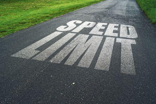 Speed Limit message reminder on asphalt road