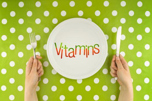 Woman eating vitamins, top view