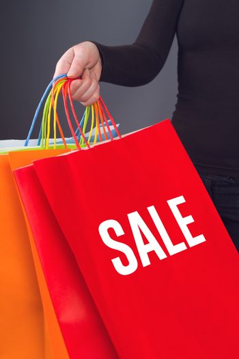 Sale Title printed on Red Shopping Bag