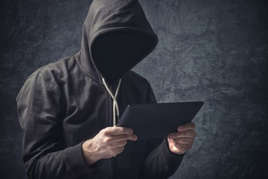 Anonymous unrecognizable man with digital tablet computer