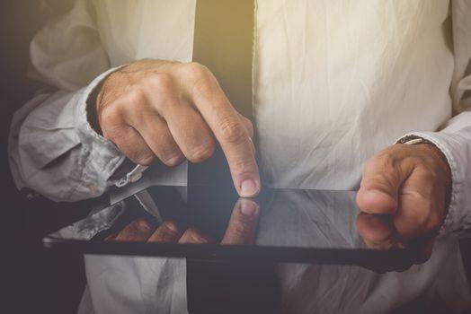Businessman working on digital tablet computer