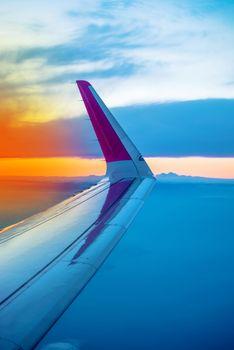 Airplane Wing Seen Through Porthole Window