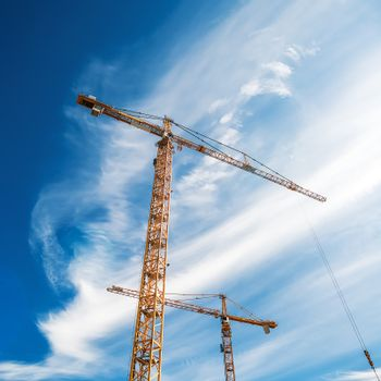 Cranes Working on Construction Site