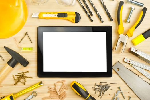 Digital Tablet and Assorted Carpentry Tools  on Workshop Table