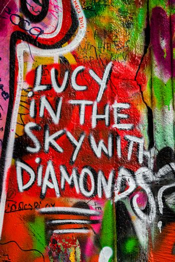 PRAGUE, CZECH REPUBLIC - MAY 21, 2015: Lucy in the Sky with Diamonds. Famous John Lennon Wall on Kampa Island in Prague filled with Beatles inspired graffiti and lyrics since the 1980s.