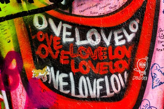 PRAGUE, CZECH REPUBLIC - MAY 21, 2015: Love Lips Smiling Graffiti on Famous John Lennon Wall on Kampa Island in Prague filled with Beatles inspired graffiti and lyrics since the 1980s.