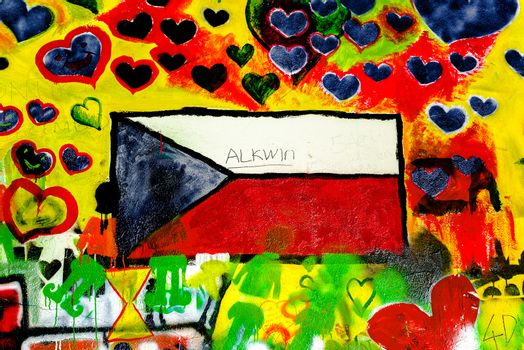 PRAGUE, CZECH REPUBLIC - MAY 21, 2015: Czech Republic Flag on Famous John Lennon Wall on Kampa Island in Prague filled with Beatles inspired graffiti and lyrics since the 1980s.