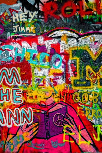 PRAGUE, CZECH REPUBLIC - MAY 21, 2015: Colorful Detail from Famous John Lennon Wall on Kampa Island in Prague filled with Beatles inspired graffiti and lyrics since the 1980s.