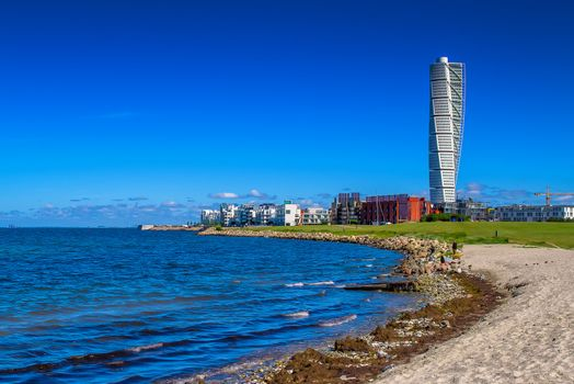 MALMO, SWEDEN - JUNE 26, 2015: Malmo West Harbor Oresund Area Cityscape with Turning Torso as Distinctive Landmark of this Swedish Town and Largest Building in Sweden, as well as in whole Scandinavia, Horizontal Image