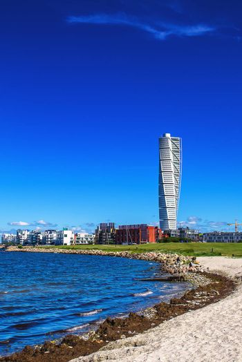 MALMO, SWEDEN - JUNE 26, 2015: Malmo West Harbor Oresund Area Cityscape with Turning Torso as Distinctive Landmark of this Swedish Town and Largest Building in Sweden, as well as in whole Scandinavia, Verticall Image