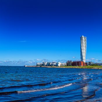 MALMO, SWEDEN - JUNE 26, 2015: Malmo West Harbor Oresund Area Cityscape with Turning Torso as Distinctive Landmark of this Swedish Town and Largest Building in Sweden, as well as in whole Scandinavia, Square Image