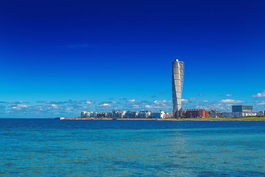 MALMO, SWEDEN - JUNE 26, 2015: Malmo West Harbor Oresund Area Cityscape with Turning Torso as Distinctive Landmark of this Swedish Town and with its 190 m is the Largest Building in Sweden, as well as in whole Scandinavia, Horizontal Image