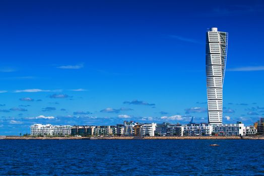 MALMO, SWEDEN - JUNE 26, 2015: Malmo Cityscape with Turning Torso as Distinctive Landmark of this Swedish Town. Malmo is the capital city in Skane County, also the third largest city in Sweden.