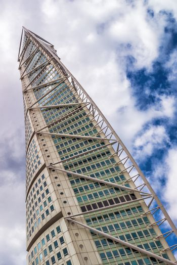 MALMO, SWEDEN - JUNE 25, 2015: Malmo Turning Torso, Swedish City Landmark is the Tallest Building in Sweden and whole Scandinavia measuring 190 meters (623 feet).
