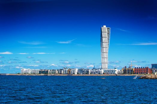 MALMO, SWEDEN - JUNE 26, 2015: Malmo West Harbor Area Cityscape with Turning Torso as Distinctive Landmark of this Swedish Town, Malmo has an mild oceanic climate mainly because of the Gulf Stream.