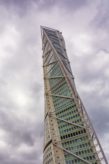 MALMO, SWEDEN - JUNE 25, 2015: Malmo Turning Torso, Distinctive Swedish City Landmark is the Tallest Building in Sweden and whole Scandinavia measuring 190 meters.