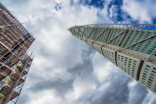 MALMO, SWEDEN - JUNE 25, 2015: Malmo Turning Torso, City Landmark and Tallest Building in Scandinavia. Construction started in summer of 2001 and official opening was on 27 August 2005.