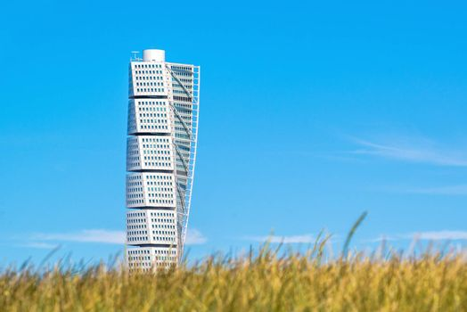 MALMO, SWEDEN - JUNE 26, 2015: Malmo Turning Torso, Distinctive Swedish City Landmark and Tallest Building in Scandinavia had Construction Costs, by claims, almost Double the Estimate.