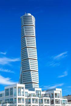 MALMO, SWEDEN - JUNE 26, 2015: Malmo Turning Torso, Distinctive Swedish City Landmark is designed by Spanish architect Santiago Calatrava and belongs to Neo-futuristic architectural style.