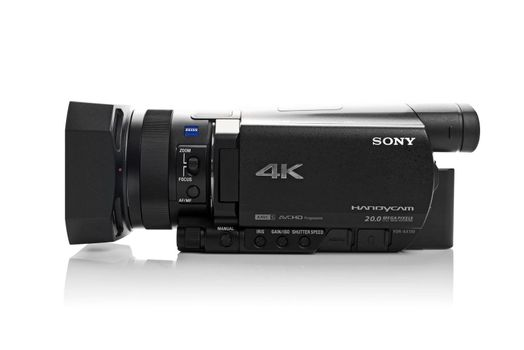 NOVI SAD, SERBIA - APRIL 25, 2015: Sony FDR AX100 4k Handycam Camcorder (announced in 2014.) captures Ultra High Definition Footage. Illustrative editorial for product isolated on white background.