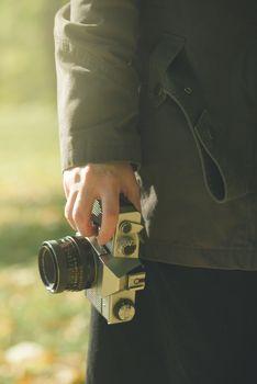 Female photographer exploring autumn nature landscapes and takin