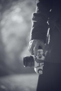Hipster female photographer exploring autumn nature landscapes a