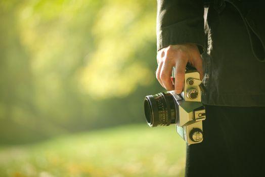 Hipster photographer exploring autumn nature landscapes