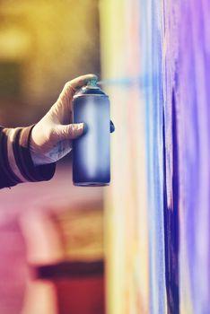 Graffiti Artist Paint Spraying the Wall