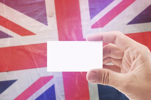 Man Holding Blank Business Card Against United Kingdom Flag