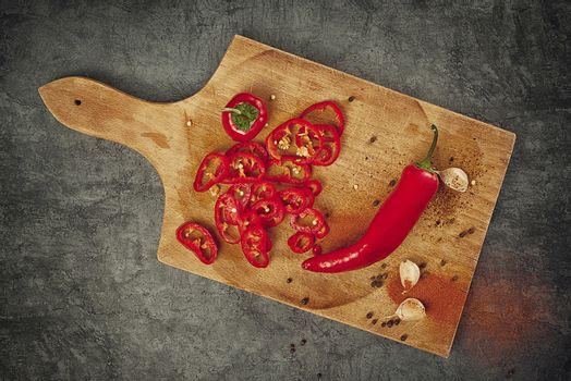 Red Hot Chili Pepper, Spice and Organic Garlic on Wooden Kitchen Plate as Hot Food Ingredients for Spicy Piquant Cuisine, Top View