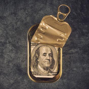 Hundred Dollar Bill in Open Empty Sardine Fish Tin Can