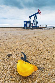 Pumpjack Oil Pump And Protective Helmet