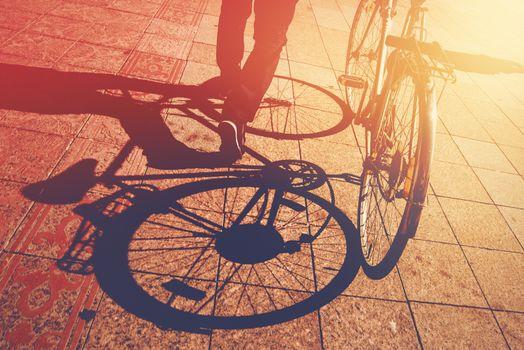Shadow on Pavement, Man Pushing Bicycle