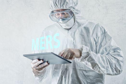 Medical Scientist Reading About MERS Virus on Figital Tablet Com