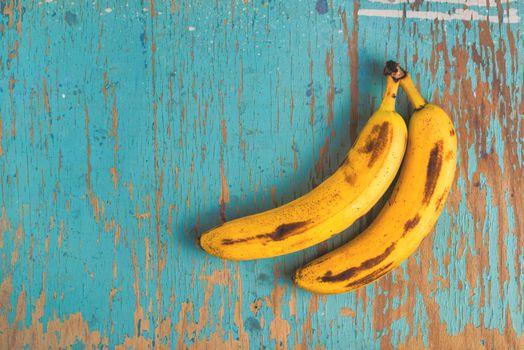 Bananas on rustic table
